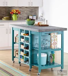 If you can't find an island to fit your exact needs, assemble your own! We added false backs to two kitchen carts, then painted them teal. We secured two wine racks and two shoe cubbies together and painted them aqua. After sandwiching the cubby units between the two carts with the open sides facing out, we added rubber casters and a MDF top designed with a 1-inch overhang and a sleek faux-concrete finish.