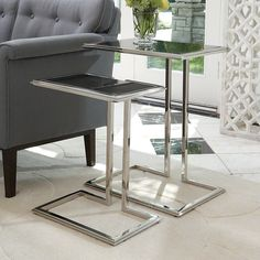 """9.92485Cozy Up Table-Stainless Steel Finish-Lg 19.5""""L x 13.5""""W x 24.5""""H  9.92486Cozy Up Table-Stainless Steel Finish-Sm 16""""L x 10""""W x 20""""H  This wonderful Global Views table can function alone or as a set when a Large and Small are purchased. They stack nicely together to save space. This amazing table is constructed from Stainless steel and has a black granite top."""