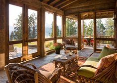 Rustic screened porch interior.