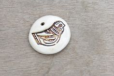Shop for ceramic on Etsy, the place to express your creativity through the buying and selling of handmade and vintage goods. Ceramic Pendant, Porcelain, Pendants, Trending Outfits, Ceramics, Bird, Unique Jewelry, Handmade Gifts, Etsy