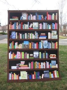 Custom Bookcase Quilt - bookshelves, books, knickknacks by SewItSeamsCreations on Etsy https://www.etsy.com/uk/listing/219056902/custom-bookcase-quilt-bookshelves-books