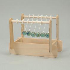 Newton's Cradle Assembly Kit #093560 Make your own Newton's cradle! You can learn about the law of conservation of momentum. Pull one ball away and let it fall. It will strike the first stationary ball in the series and come...