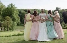 mixed pastel bridesmaid dresses | Image by Magdalena Martin Photography