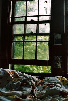 open window + unmade bed