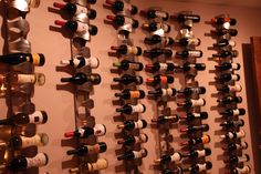 wine rack with stacked ikea stainless steel wine racks -- 4 per column. Useable art -- labels are easy to read and decorative