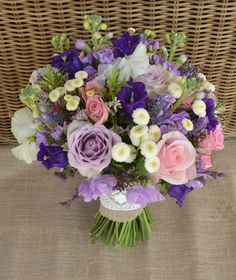 Just picked look bouquet in purples, lilacs, pinks and ivory. Featuring Roses, Campanula, Stocks, Sweetpeas, Matricaria Daisy, Misty and Spray Roses.