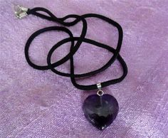 Amethyst Gemstone Heart Pendant - 22x23mm comes on velvet necklace.<br/>WEAR NATURAL STONE JEWELRY FOR ENERGY ENHANCEMENT!!<br/><br/>ITEM DESCRIPTION:<br/>Stone Type: Amethyst<br/>Approximate Stone Size: 22 mm x 23 mm<br/>Please Note: Pin which is inserted into drilled hole of this pendant is held in place not only by the fit and screw of it but also by professional jeweler's bond resin to be sure of stability.<br/><br/>General Gemstone Details<br/>Amethyst is a purple quartz believed by the…