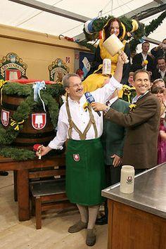 Munich mayor Christian Ude taps the first keg of Oktoberfest beer.,