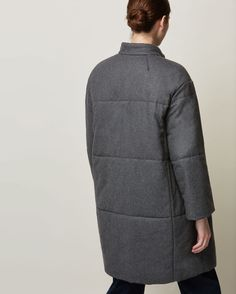 Oversized quilted coat in a soft wool blend flannel. Rounded, Chinese-style collar. Two large poppers to fasten at front. Two pockets. Contrasting gingham cotton lining.