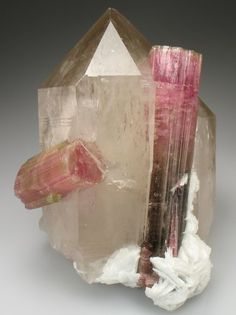 A magnificent Himalaya Mine Tourmaline, featuring two crystals intergrown in a large Smoky Quartz.