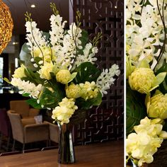 An artificial flower arrangement using Koch  Co's silk orchids and warratah's, displayed in a chrome trumpet vase.
