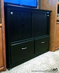 An Old Cabinet Gets Converted Into An Entertainment Center