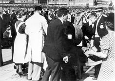 1943. Jewish citizens are served some water while waiting at an assembly point in Amsterdam for deportation to transition camp Westerbork. #amsterdam #worldwar2