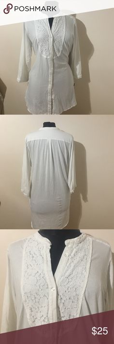 DKNY TUNIC DKNY white tunic top button up from with lace decoration at bust 3/4 in button sleeves 2 side pockets a little longer in back. Supper soft with a little stretch. Could be work week chic paired with nice slacks and heels or casual with legging and boots. DKNY Tops Tunics