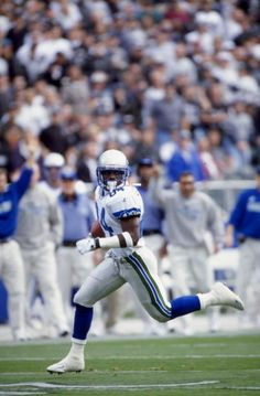 Joey Galloway of the Seattle Seahawks in action during the game against the Oakland Raiders at the Oakland Coliseum in Oakland California The Raiders. Seahawks Pictures, Oakland Coliseum, Oakland California, National Football League, Seattle Seahawks, Oakland Raiders, Wave, The Past, Action