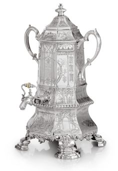 "A Victorian silver ""Chinoiserie"" presentation tea urn of Irish interest, Joseph Angell and Son, London, 1844 octagonal, the sides engraved with colonettes, Mandarin figures, rococo architecture, and squirrels and birds perched in trees, the front with 1851 presentation inscription, the back with initials and crest."