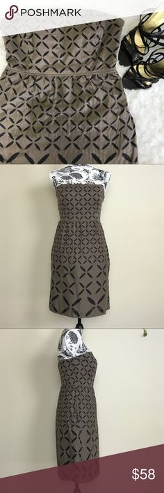 """J.Crew Brown Strapless Ginny Dress J.Crew strapless Ginny Dress in brown. Has eyelet pattern throughout the whole dress. Empire waist. Side concealed zipper with fish and hook closure. Upper bodice has wires for extra support and silicone lining for anti-slipping. Has extra band inside with fish and hook closure. Fully lined. Side pockets. Length measures at 29"""" and bust at 15"""". J. Crew Dresses Strapless"""