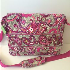 """Vera Bradley Messenger Plaid Meets Paisley This messenger bag is the perfect size for all your work or school essentials.   Features: hard bottom that can be removed for cleaning; front flap can be secured; two cute zip close slash pockets on the front (covered by flap); three interior slip pockets and a pen pocket. Adjustable padded shoulder strap.                   Measurements: length 15""""; height 11.5; width about 4.5""""; strap up to about 23""""  NWT Vera Bradley Bags"""