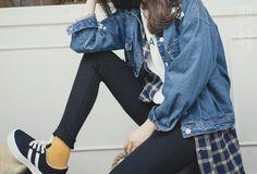 dark jeans, white graphic tee, plaid, denim jacket, mustard socks, black sneakers