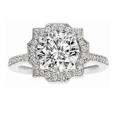 Belle by Harry Winston, Round Brilliant Diamond Engagement Ring Round brilliant diamond, featured here in 2.03 carats, in a micropavé platinum setting.)