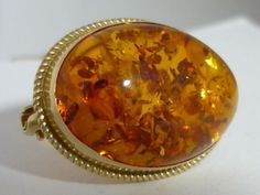 "It is fully hallmarked with for gold, the anchor for Birmingham and makers mark ""RMS"". The amber looks amazing, the inclusions just incredible. Silver Jewelry, Fine Jewelry, Gold Brooches, Animal Sculptures, Makers Mark, Punch Bowls, Amber, Jewelry Watches, Vintage"