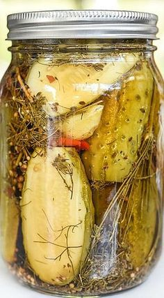 Spicy Killer Garlic Dill Pickles ~ A healthy dose of fresh, peeled garlic cloves, a homemade pickling spice recipe and hot peppers give these dill pickles a seriously delicious kick. Garlic Dill Pickles, Pickled Garlic, Spicy Pickled Eggs, Spicy Pickle Recipes, Canning Recipes, Pickeling Recipes, Canning Labels, Canning Tips, Jelly Recipes