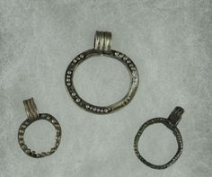 Roman silver jewelry, roman silver pendants with loop, 1st-3rd century A.D. Roman silver pendant with loop, 3 cm max. Private collection