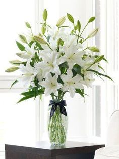 Oriental Lilies (bouquet... I'm not sure how if I want them everywhere at the reception. They're naturally a focal point, and I want there to be a more spring than summer feel.)