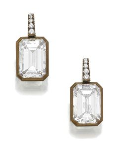 A pair of diamond earrings by Hemmerle. Each set with a step cut diamond weighing respectively 4.14 and 4.19 carats, suspended from a row of brilliant cut stones