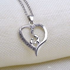 Wholesale Mom And Baby Love Pendant Necklace Heart Angel Wing Little Feet Name Silver Mix Modles Mom Gift Jewelry Free Dhl Horseshoe Pendant Necklace Silver Pendant Necklaces From Annychan27, $1.51| Dhgate.Com