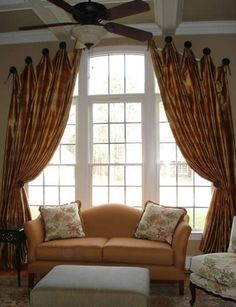 This is NOT what you want to do with a gorgeous window....window treatment should not be an eye magnet, especially not the pegs they are hung on