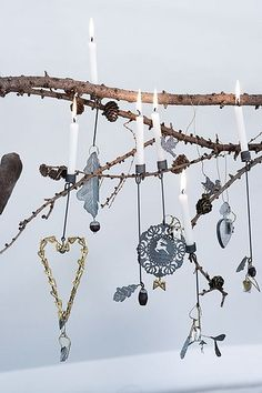 Hang candles and decorations on a branch from the garden.