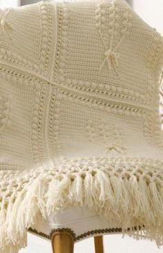 Bring the essence of Ireland into your home with this simple Aran Crochet Throw. This free crochet afghan pattern makes a great gift for a housewarming.