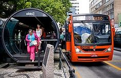 Unable to afford an underground subway system, Curitiba, Brazil has implemented rapid bus infrastructure to make transit more efficient. Passengers pay their fare in advance, wait in a tube, and quickly enter the bus without fumbling for change. The buses, each system with a different color, each have their own road lane so they don't get stuck in traffic. What a low-cost easy solution for freeing up automotive congestion and making public transportation more convenient and accessible.
