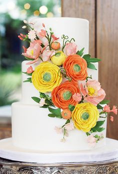 For a spring wedding at the Ladybird Wildflower Center in Texas, cake designer Paloma Efron of Coco Paloma Desserts created this vibrant cake (flavored with rosewater jam!) to complement the bride's ranunculus-and-poppy bouquet.   $12 per slice, Coco Paloma Desserts
