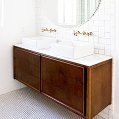 Mid-century modern vanity. Square vessel sinks continue the square/rectangular motif of the vanity and subway tiles.