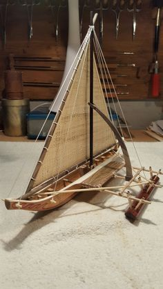 Sailing Canoe brailed on starboard tack, Jaliut Lagoon, Marshall Islands - Marshall Islands - Wikipedia Wooden Model Boats, Wooden Boats, Model Ship Building, Boat Building, Canoe For Sale, Ship In Bottle, Outrigger Canoe, Boat Art, Wooden Ship