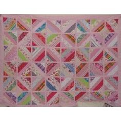 Memory Quilt...made from her daughters dresses she wore as a child.