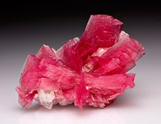 Rough Rhodonite  Origin: Peru  Extremelly rare to find Transparent specimens, take its pink coloration from the Manganese (Mn).  Gems at the corner: Photo