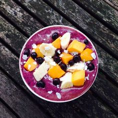 Blueberry & banana smoothie bowl topped with blueberries, banana, mango & shaved coconut