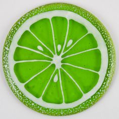 Fused Glass Coaster - Fruit Slice – Lime - £9. Hand painted with a paint that is permanently fused into the glass. Diameter approximately 10cm, with clear rubber bumpers on the base to keep them in place and protect your furniture. www.glassbygenea.co.uk #fusedglass
