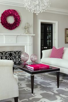 benjamin moore revere pewter is a lovely light to mid tone gray paint colour that is not too cool feeling. Shown in this living room with pink accents Lightened by 1/2