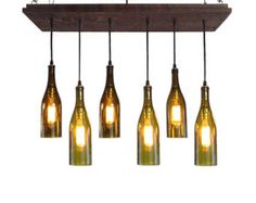 Recycled Wine Bottle Chandelier - *This Item Was Featured On The Front Page Of ETSY!* This unique rustic cottage style chandelier is handmade and stained a distressed Bleached Grey color. Wiring is black with antique gilt hardware and has four cascading recycled Clear wine bottle pendants. DETAILS Base: 15.5 x 15.5 with recessed frame Finish: We have 9 color options to choose from Cord: basic black Sockets: antique gilt Pendants: 4 Clear Wine Bottles The longest bottle hangs 22 from the…