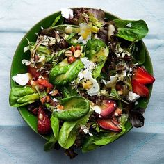 some spinach, cherry tomatoes, a bunch of strawberries, raspberries, blueberries (or any kind of berry you LOVE), a ton of feta cheese and parmesan (it's my favourite), walnuts and cashews, olive oil and a little bit of pepper