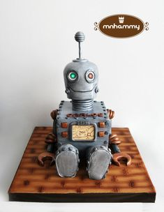 Hello!!! this is 100% cake made for a teacher who loves domotic and every kind of gadgets, and also love to travel. that is the reason for the gps with his dream destination! The eyes had little sparkling led lights!