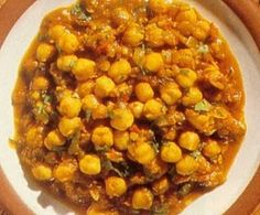 This dish features chickpeas, with their faintly nut-like flavour and smooth texture. Chickpeas are rich in protein-nitrogen compounds. Cooked in this spicy Veg Recipes, Indian Food Recipes, Vegetarian Recipes, Ethnic Recipes, Indian Foods, Vegan Vegetarian, Recipies, Punjabi Food, Tv Chefs