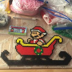 Christmas Santa Mario perler beads by tyler_plurden Perler Bead Templates, Diy Perler Beads, Pearler Beads, Pony Bead Patterns, Hama Beads Patterns, Beading Patterns, Mario Crafts, Perler Bead Mario, Christmas Perler Beads