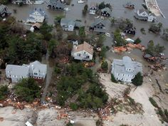 Damages, adaptation costs from sea level rise, storm surge roughly double those from sea level rise alone
