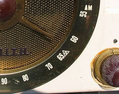 """By law, radio sets manufactured between 1953 and 1963 had these frequencies marked by the triangle-in-circle (""""CD Mark"""") symbol ofCivil Defense."""