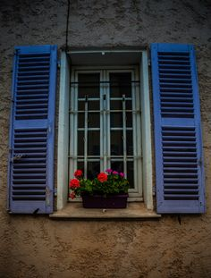 Window shutter in Provence in serenity blue